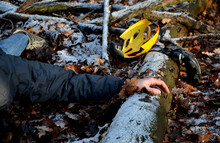 Despite Protective Equipment, The Man Ended Up Injured With A Shattered Helmet On The Ground In The Woods After Falling From A Bicycle. Without Help He Dies Of Hypothermia
