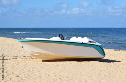 Fotografie, Obraz Motorboat on the beach near the sea on a sunny day