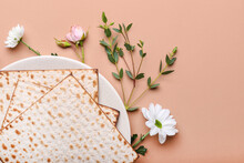 Plate With Jewish Flatbread Matza For Passover And Flowers On Color Background