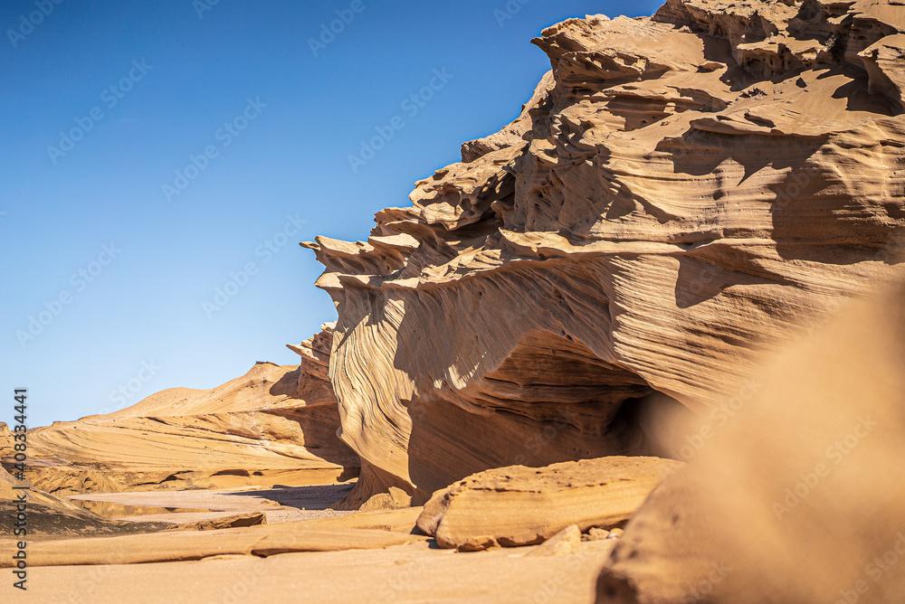Fototapeta Sunlit sandstone rock formation in the Atlantic coast near Agadir, Morocco