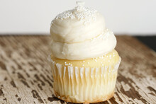 Vanilla Cupcake With Sweet Frosting And White Sprinkles
