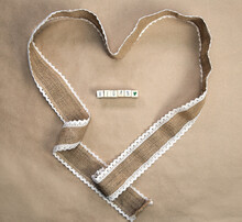 Flat Lay Design,natural Burlap Ribbon In Heart Shape With The Text VEGAN Written And Craft Paper Background Texture, Top View, Healht, Vegan, Vegetarian Concept