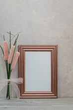 Rose Gold Frame Mockup With Pink Cattail Flowers Against Pink Textured Wall For Art Or Copy Space