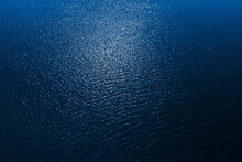 Aerial View To Deep Blue Water In River With Sunlight