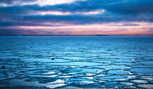 Frozen Baltic Sea. Cold Winter Landscape. Colorful Sunset Over Sea Covered By Ice Tiles. Composition Of Nature. Beautiful Natural Seascape. Ice On Water Surface. Breathtaking View. Blue Hour. Finland.
