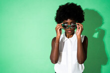Young Woman Wearing Sunglasses While Standing Green Background