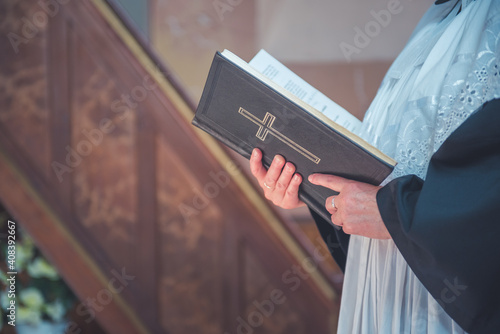 Canvas Pope holding a Bible in the church.