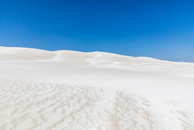 Clear Blue Sky Over White Sand Dunes