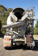 Rear View Of Concrete Truck Delivering Concrete To Building Site