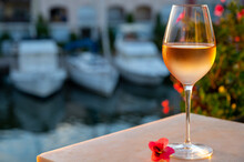 Tasting Of Local Rose Wine In Summer With Sail Boats Haven Of Port Grimaud On Background, Provence, France