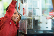 4 Year Old Mixed Race Boy Presses A Souvenir Penny At A Local Sydney Tourist Attraction