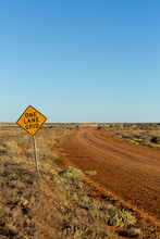 Road Sign Beside Gravel Road In Outback NSW