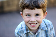 Portrait Of A Young Boy Smiling At Camera