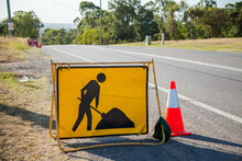 Yellow Digging Road Work Signs On Road