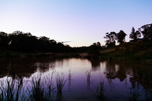Dusk Light Over Nowlan Park Dam And Reeds
