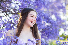 Laughter On The Face Of Young Teen Girl With Purple Bokeh Background
