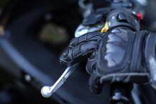 Detail Of Motorbike Glove Holding Handlebar