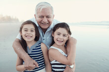 Happy Multicultural Grandparent With Grandchildren On The Beach