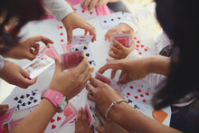 Children Having Fun With Playing Card Game