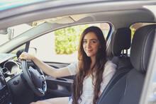 Teenage Girl Sitting In The Car