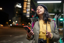 Woman Waiting His Uber Service In The Street At Night