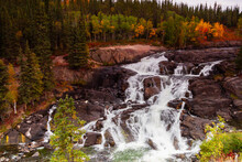 Early Fall Colours Provide Contrast To The Stark Rock Framing Cameron Falls Along The Ingraham Trail In Canada's Northwest Territories
