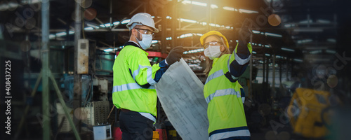 Canvas Print Engineer team wearing face mask, reflective vest and helmet check and control in
