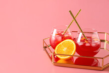 Tray With Glasses Of Fruit Ice Tea On Color Background