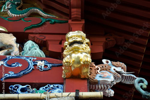 Obraz na plátně The gold guardian dog at Musashi Mitake Shrine.