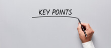 Businessman Hand Underlining The Word Key Points On Gray Background. Highlighting The Key Points Of An Issue In Business