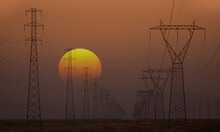 High Voltage Power Lines With Amazing Sunset