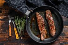 Grilled Skirt Machete Steak In A Pan.  Dark Wooden Background. Top View