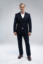 Full Length Shot Of A Mature Businessman Wearing A Suit Looking At Camera