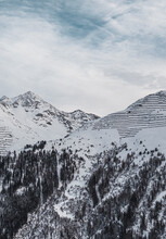 Vertical View Of Mountains With Snow, Trees, And Avalanche Breakers Near St. Anton, Austria