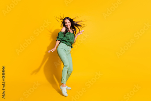 Obraz Photo portrait full body view of dancing girl isolated on vivid yellow colored background with blank space - fototapety do salonu