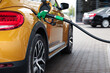 Refueling modern car at gas filling station, closeup