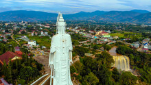 Aerial View Of  Linh An Pagoda, DaLat City, Lam Dong Province, Vietnam. A Statue Is White And 71 Meters High. Selective Focus. Thac Voi Waterfall, Forest And City Scene In Background.