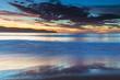 Pretty blue summer sunrise seascape with high cloud