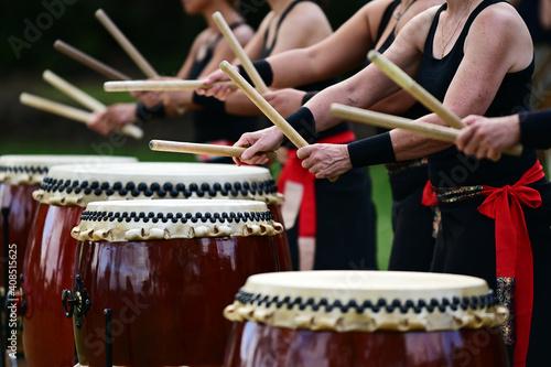 Taiko drummers drumming on Japanese Drums Fototapeta