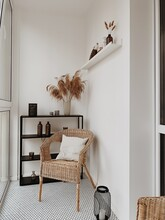 Beautiful White Loggia In Scandinavian Style With Rattan Chairs, White Pillow, Black Shelf, Vases, Pampas Grass, Candles. Nordic, Higgle Concept.