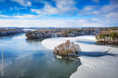 Obraz Aerial landscape of the frozen lake in Poland at winter - fototapety do salonu