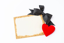 Blank Vintage Style Paper Card With Black Ribbon And Red Heart On White Background, Love And Romance Concept, Valentine Card Background Idea