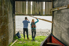 Unrecognizable Couple In Boat Shed