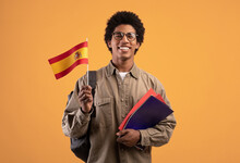 Learning New Language, Education And Travel. Young Smiling African American Male With Backpack Hold Notebooks