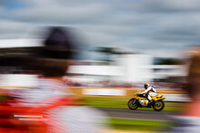 Rear View Of Spectator Looking At Racer Riding Motorcycle During Racing