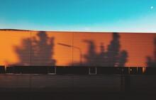 Shadow On Warehouse Against Clear Sky