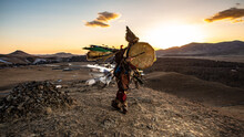 Traditional Dancer On Field Against Sky During Sunset