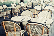 Empty Tables And Chairs At Sidewalk Cafe