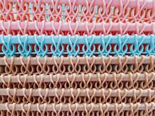 Full Frame Background Of Colorful Plastic Basket Pattern Stacks