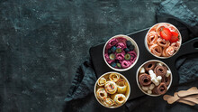 Rolled Ice Cream In Cone Cups On Dark Background. Different Iced Rolls Top View Or Flat Lay. Thai Style Rolled Ice Cream With Copy Space In Center For Text Or Design. Banner